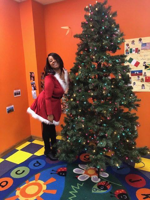 Amalia Herrera poses as she celebrates Christmas with her preschool students.